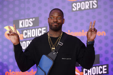 FILE PHOTO: Kids Choice Sport Awards 2018 – Arrivals – Los Angeles, California, U.S., 19/07/2018. Martellus Bennett poses. REUTERS/Danny Moloshok - HP1EE7J1PRC4Q