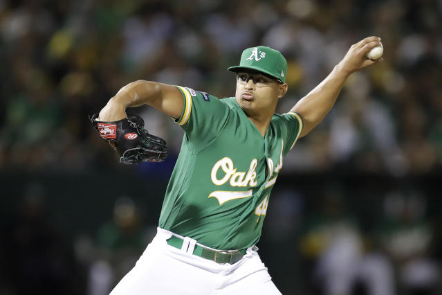 Oakland Athletics pitcher Jesus Luzardo throws to a Tampa Bay Rays batter during the sixth inning of an American League wild-card baseball game in Oakland, Calif., Wednesday, Oct. 2, 2019. (AP Photo/Ben Margot)