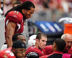 Cardinals WR Larry Fitzgerald checks on Max Hall after a big first-half hit on the quarterback