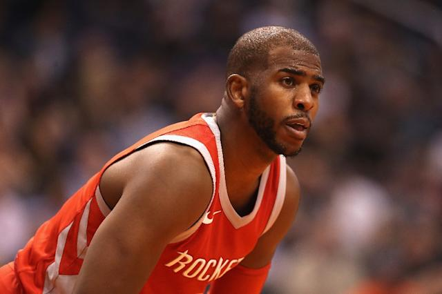 "<a class=""link rapid-noclick-resp"" href=""/nba/players/3930/"" data-ylk=""slk:Chris Paul"">Chris Paul</a> has clearly been working on dribbling skills with his son. (AFP)"