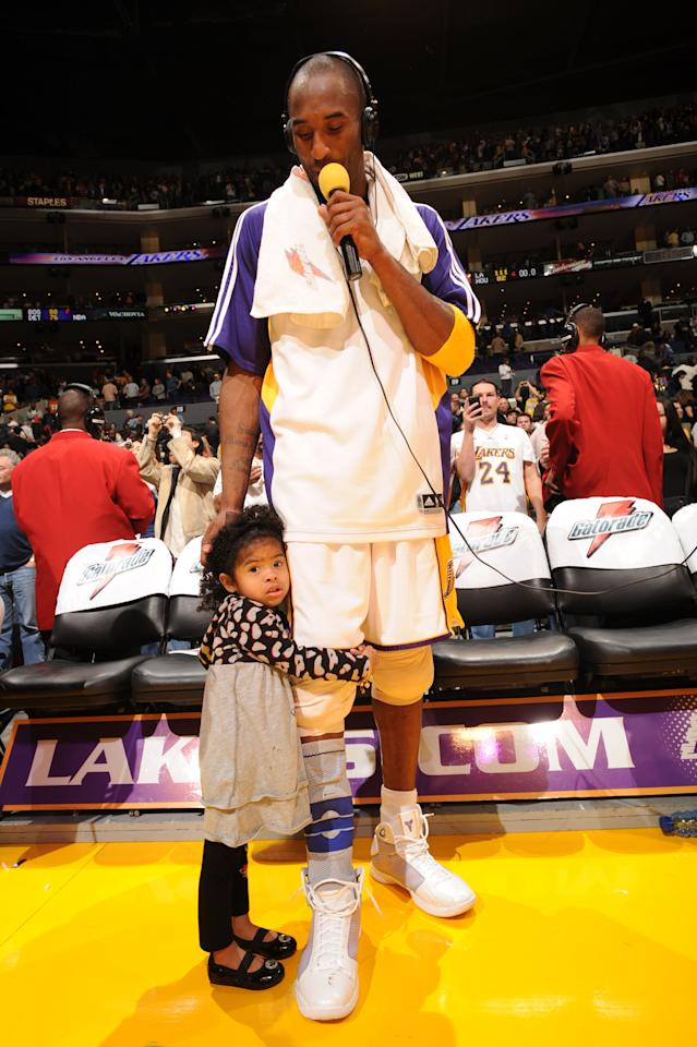 Kobe Bryant #24 of the Los Angeles Lakers participates in a post-game interview while his daughter, Gianna stands with him following the Lakers' victory over the Houston Rockets at Staples Center on November 9, 2008 in Los Angeles, California. (Photo by Andrew D. Bernstein/NBAE via Getty Images)