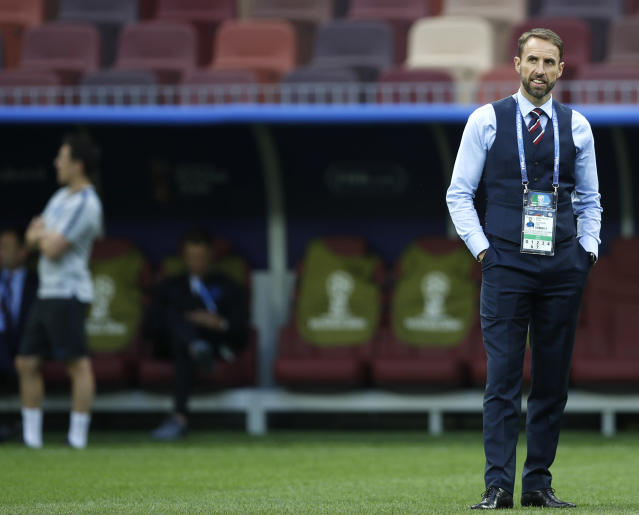 England head coach Gareth Southgate inspects the pitch prior to the semifinal match between Croatia and England at the 2018 soccer World Cup in the Luzhniki Stadium in, Moscow, Russia, Wednesday, July 11, 2018. (AP Photo/Francisco Seco)