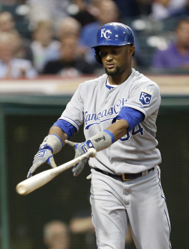 Kansas City Royals' Emilio Bonifacio throws his bat after striking out against Cleveland Indians starting pitcher Ubaldo Jimenez in the third inning of a baseball game, Monday, Sept. 9, 2013, in Cleveland. (AP Photo/Tony Dejak)