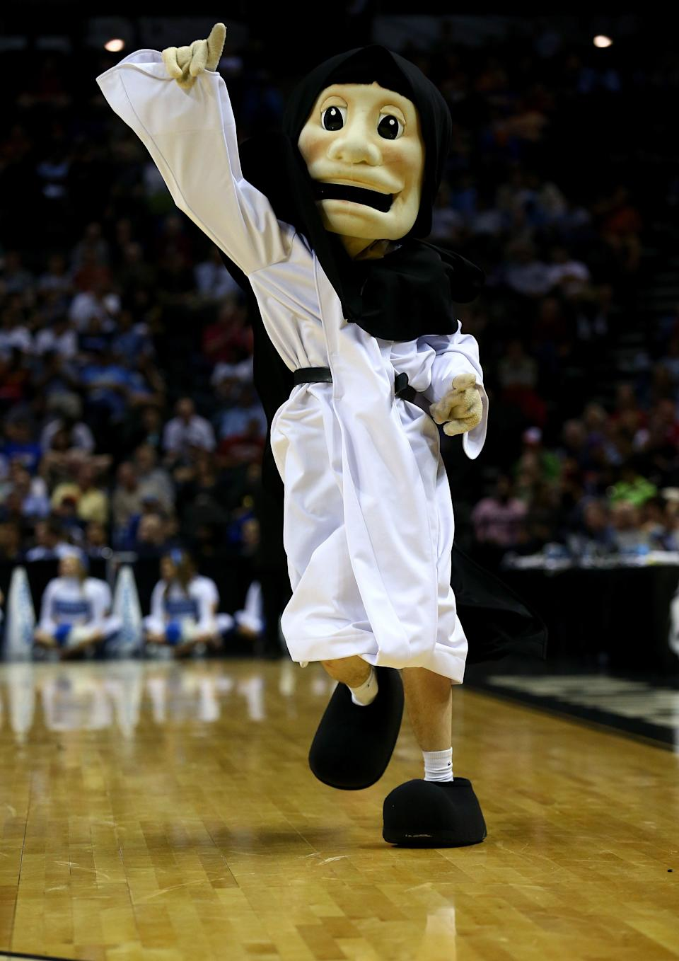 SAN ANTONIO, TX - MARCH 21: The Providence Friars mascot performs during a first half timeout against the North Carolina Tar Heels  during the second round of the 2014 NCAA Men's Basketball Tournament at AT&T Center on March 21, 2014 in San Antonio, Texas.  (Photo by Tom Pennington/Getty Images)