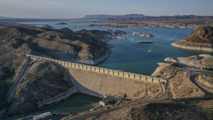 """<div class=""""inline-image__caption""""><p>This undated file photo shows the dam at Elephant Butte Lake in Elephant Butte, N.M. Many New Mexico communities are behind the curve when it comes to investing in drinking water infrastructure as persistent drought threatens supplies, and the state's fragmented funding process makes it hard to know what taxpayers are getting for their money, legislative analysts said Wednesday, June 23, 2021. </p></div> <div class=""""inline-image__credit"""">Roberto E. Rosales/The Albuquerque Journal via AP</div>"""