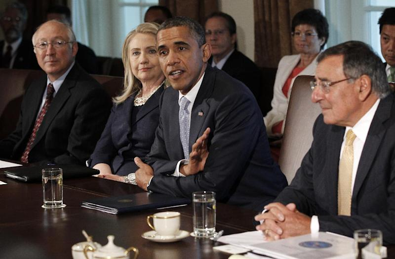 President Barack Obama meets with members of his cabinet in the Cabinet Room of the White House in Washington, Thursday, July, 26, 2012. From left are, Interior Secretary Ken Salazar, Secreatry of State Hillary Rodham Clinton, the president and Defense Secretary Leon Panetta. (AP Photo/Pablo Martinez Monsivais)