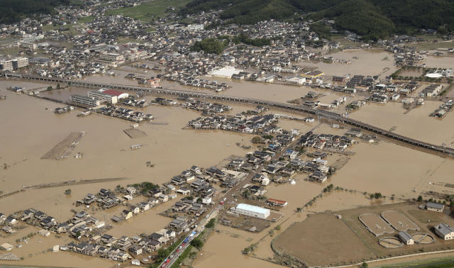 <p>This photo shows an submerged housing area in Kurashiki, Okayama prefecture, western Japan, July 9, 2018. People prepared for risky search and cleanup efforts in southwestern Japan on Monday, where several days of heavy rainfall had set off flooding and landslides in a widespread area. (Photo: Kyodo News via AP) </p>