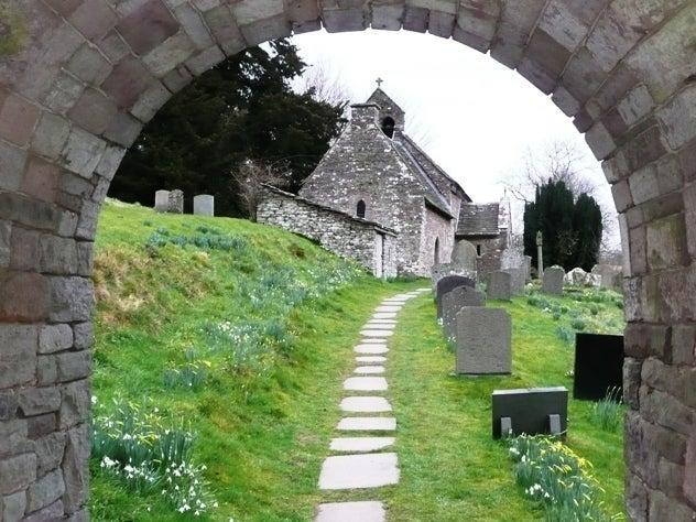 New archaeological research has increased the number of Dark Age Celtic probable saints in Britain by almost 30%. Most of the previously known Celtic saints had only been attested through medieval church dedications – like this remote parish church (in the Welsh village of Partrishow), once dedicated to St Issui, a Dark Age Martyr.WikiCommons