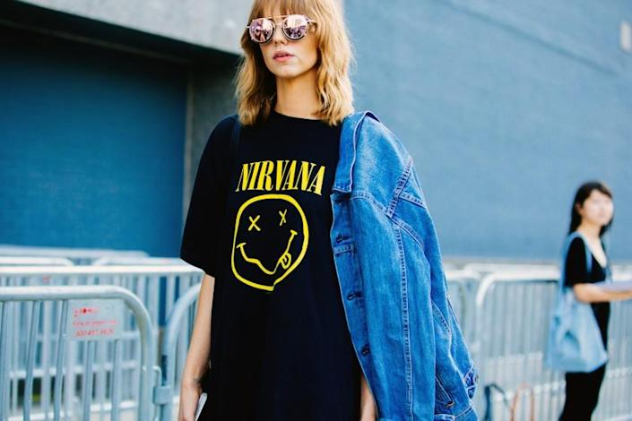 Model Michi Delane wears vintage-style reflective sunglasses and a black Nirvana t-shirt