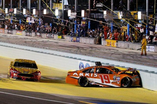 Carl Edwards crashes into the inside wall. (Getty Images)