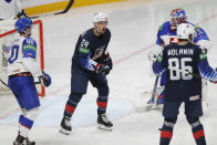 Sasha Chmelevski of the US, center, celebrates after scoring his side's fifth goal during the Ice Hockey World Championship quarterfinal match between the United States and Slovakia at the Arena in Riga, Latvia, Thursday, June 3, 2021.(AP Photo/Sergei Grits)