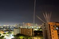 FILE PHOTO: Streaks of lights are seen from Ashkelon as rockets are launched from the Gaza Strip towards Israel