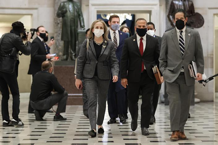 """Impeachment managers (L-R) Rep. Madeleine Dean (D-PA), Rep. Eric Swalwell (D-CA), Rep. David Cicilline (D-RI), Rep. Jamie Raskin (D-MD) and others walk through Statuary Hall while heading to vote to impeach U.S. President Donald Trump for the second time in little over a year in the House Chamber of the U.S. Capitol January 13, 2021 in Washington, DC. The House voted 232-197 to impeach Trump on the charge of """"incitement of insurrection"""