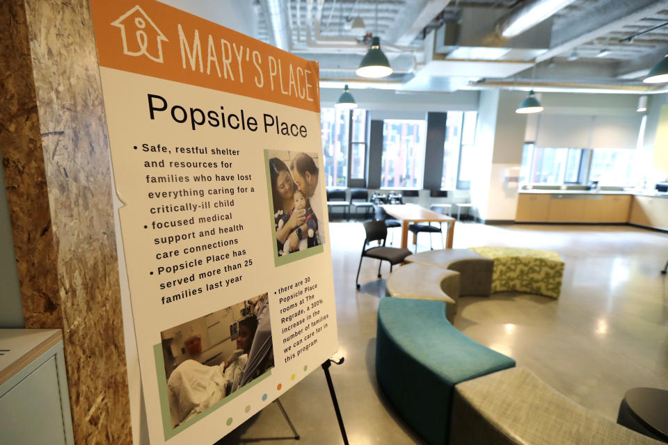 A sign outlines services offered by the Popsicle Place shelter program at Mary's Place, a family homeless shelter located inside an Amazon corporate building on the tech giant's Seattle campus, Wednesday, June 17, 2020. The Popsicle Place shelter program is an initiative to address the needs of homeless children with life-threatening health conditions. (AP Photo/Ted S. Warren)