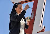 A nun in the predominantly Christian town of Qaraqosh prepares for the highly-anticipated papal visit