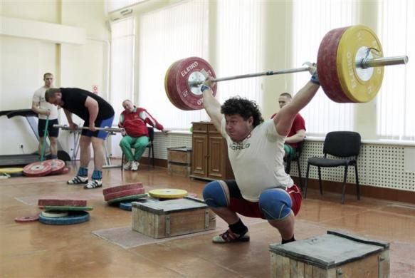 Olympic weightlifter Andrei Aramnau trains at a sport base on the outskirts of Minsk, April 18, 2012. Winning the national championship has convinced Belarussian lifter Aramnau that he has put behind two drink-driving convictions and the resultant two-year ban to be on course for a second Olympic gold. Aramnau's confidence stemmed from his victory in the national championship two months ago with a 400kg lift. The 24-year-old lifter was working overtime to get into shape and was confident of hitting top form in the London Olympics.