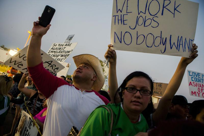 Residents and protestors attend a town hall meeting to discuss the processing of undocumented immigrants in Murrieta, California