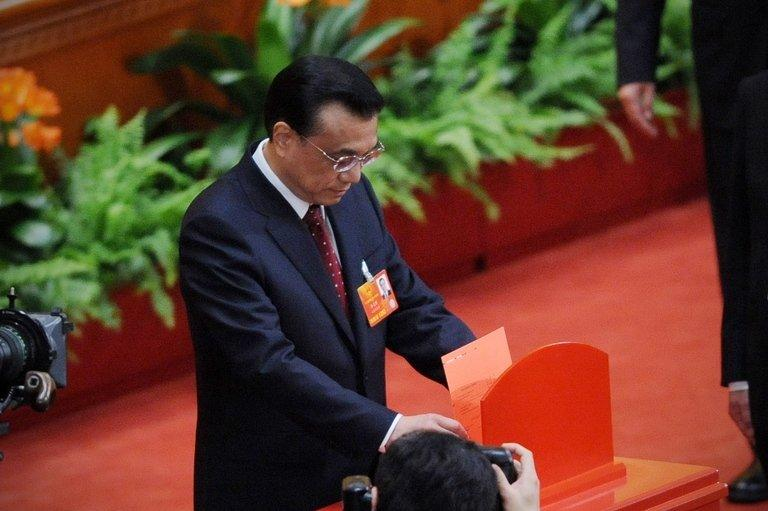 Li Keqiang casts his vote for the election for the new president of China during the 12th National People's Congress in the Great Hall of the People in Beijing, on March 14, 2013. China's parliament named Li to the post of premier on Friday, a role that involves running day-to-day government in the world's second-largest economy