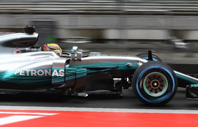 Lewis Hamilton drives through pit lane during a practice session ahead of the Formula One Chinese Grand Prix in Shanghai, where he is seeking his first win of the season (AFP Photo/GREG BAKER)