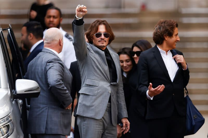 FILE PHOTO: Actors Johnny Depp and Amber Heard at the High Court in London