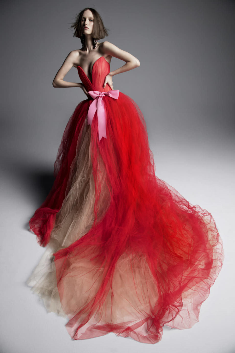 <p>Crimson strapless gown with pink bow. (Photo: Inez & Vinoodh) </p>