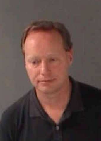 This booking photo released by the Fulton County Sheriff's Office on Thursday, Aug. 29, 2013, shows Atlanta Hawks basketball coach Mike Budenholzer. Budenholzer was arrested and charged with driving under the influence Wednesday night, Aug. 28, 2013 in Atlanta. (AP Photo/Fulton County Sheriff's Office)