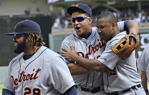 Detroit Tigers' Miguel Cabrera, center, and Delmond Young, right, celebrate the Tigers' 5-1 win over the Minnesota Twins  in a baseball game Wednesday, Aug. 15, 2012 in Minneapolis. Both Young and Cabrera homered in the game. At left is Prince Fielder. (AP Photo/Jim Mone)