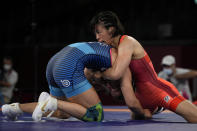 Japan's Risako Kawai, left, and United States Helen Louise Maroulis compete during the women's 57kg Freestyle semifinal wrestling match at the 2020 Summer Olympics, Wednesday, Aug. 4, 2021, in Chiba, Japan. (AP Photo/Aaron Favila)