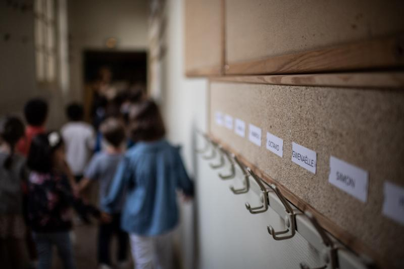 Children enter their classroom on the first day of the start of the school year, at the Chaptal elementary school in Paris, on September 2, 2019. - In France some 12.4 million students crossed the doors of elementary schools (6.7 million), secondary school (3.4 million) and high schools (2.3 million) on September 2, 2019. (Photo by Martin BUREAU / AFP) (Photo credit should read MARTIN BUREAU/AFP/Getty Images)
