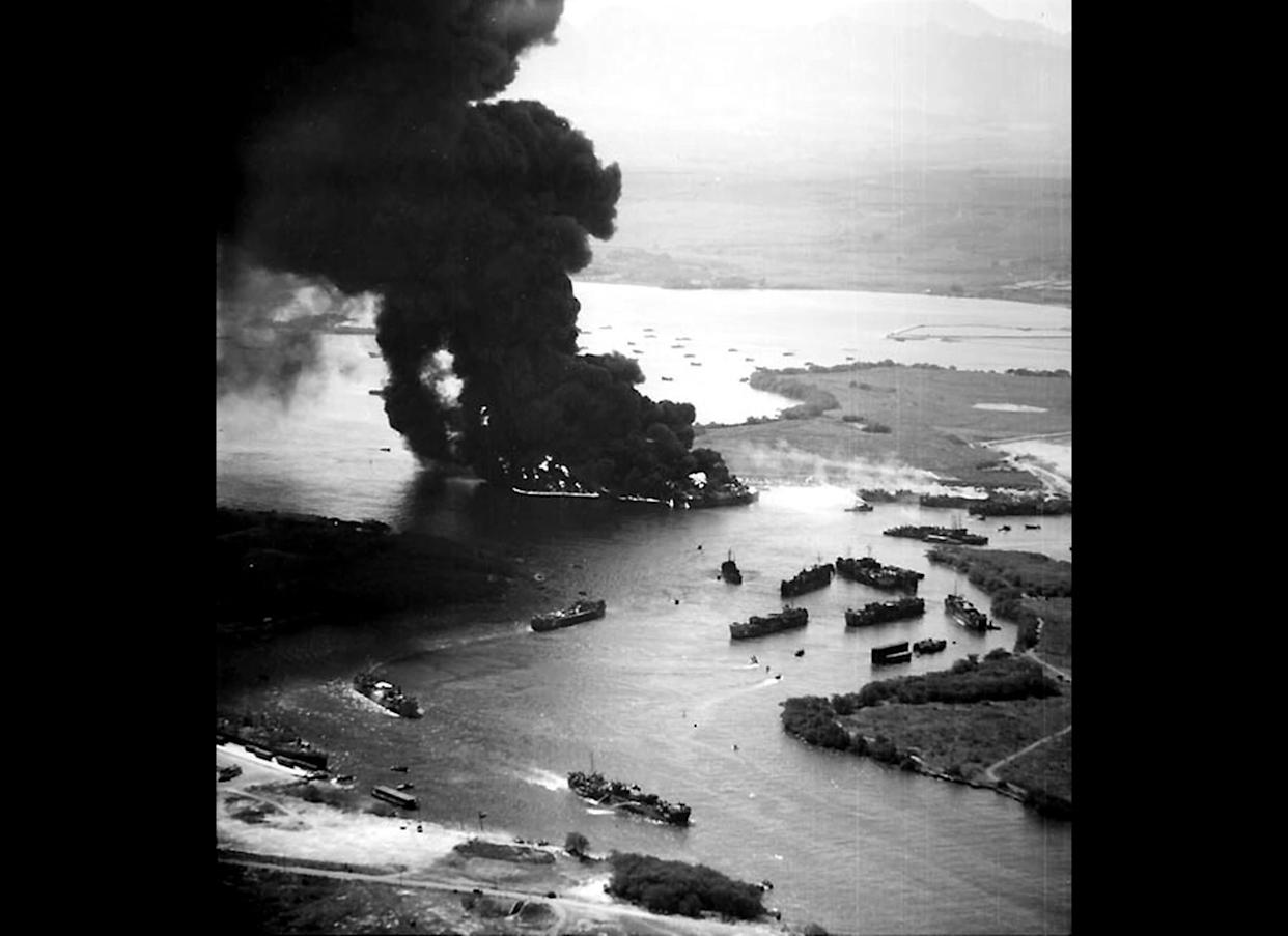 """In this photo taken May 21, 1944, the bombing of U.S. Navy vessels in the West Loch area of Pearl Harbor is seen in this photo provided by the Naval History & Heritage Command. Though the incident became known as """"The Second Pearl Harbor Disaster,"""" it has never received the attention garnered by the Japanese surprise attack, in part because its details were kept secret for almost two decades."""