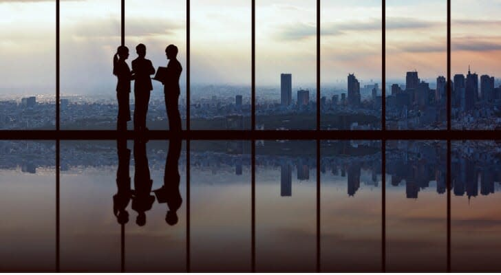 Top-level executives in an informal meeting