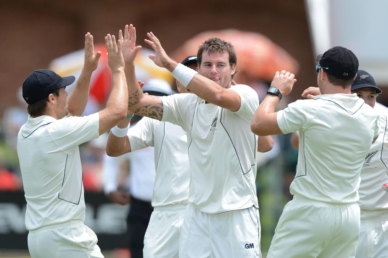 PORT ELIZABETH, SOUTH AFRICA - JANUARY 11: Doug Bracewell of New Zealand celebrates the wicket of Alviro Petersen for 21 runs during day 1 of the 2nd Test match between South Africa and New Zealand at Axxess St Georges on January 11, 2013 in Port Elizabeth, South Africa. (Photo by Duif du Toit/Gallo Images/Getty Images)
