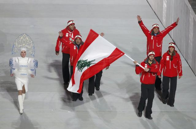 Lebanon's flag-bearer Alexandre Mohbat leads his country's contingent during the opening ceremony of the 2014 Sochi Winter Olympics, February 7, 2014. REUTERS/Lucy Nicholson (RUSSIA - Tags: OLYMPICS SPORT)