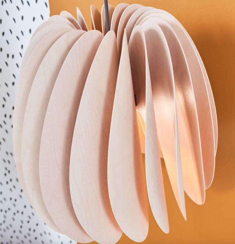 """<p>""""For the SKYMNINGEN pendant lamp we wanted to tap into Swedish design tradition and make a soft ambient lamp that highlights the natural beauty of birch,"""" says IKEA, The turbine-like shape with curved wood, a technique called 'layered glueing', is a technique never tried by the brand before. Claes Wåxnäs, the Product Developer, explains that """"when switched on, the pendant transforms the room's walls in to a delicate play of light and shadows"""".</p><p><strong><em>SKYMNINGEN pendant lamp, £85</em></strong></p>"""