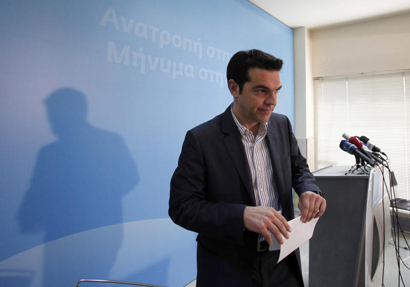 Alexis Tsipras, the leader of Greece's Radical Left Coalition party (SYRIZA) leaves after delivering a statement at the party's headquarters in Athens, Monday, May 7, 2012. Left-wing Greek election runner-up Tsipras rejected forming a coalition with the winning conservative party on Monday. (AP Photo/Kostas Tsironis)