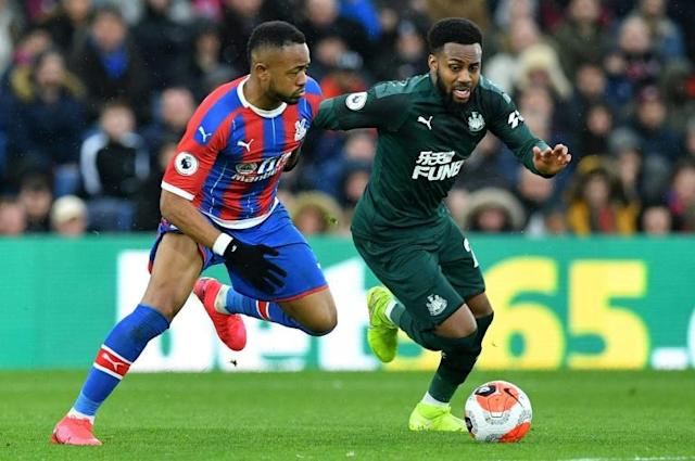 "Newcastle defender Danny Rose (right) says Premier League players are being treated like ""lab rats"" (AFP Photo/Justin TALLIS)"