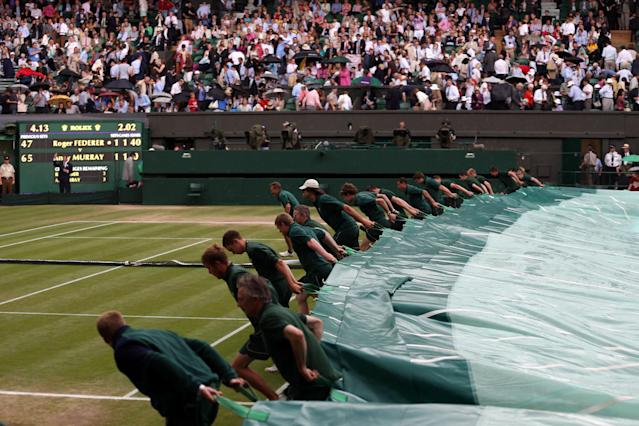 LONDON, ENGLAND - JULY 08: A general view of atmosphere as rain delays play and the court is covered on day thirteen of the Wimbledon Lawn Tennis Championships at the All England Lawn Tennis and Croquet Club on July 8, 2012 in London, England. (Photo by Julian Finney/Getty Images)