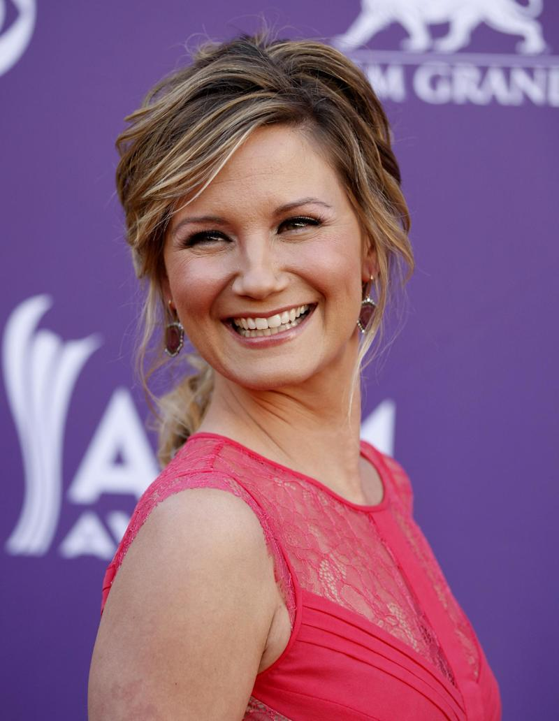 FILE - This April 1, 2012 file photo shows country singer Jennifer Nettles, of musical group Sugarland, arriving at the 47th Annual Academy of Country Music Awards in Las Vegas. Sugarland's Jennifer Nettles is releasing a solo album. Nettles says Friday, May 17, 2013 in a news release that she is working with Rick Rubin and will release the album in the fall. (AP Photo/Isaac Brekken, file)