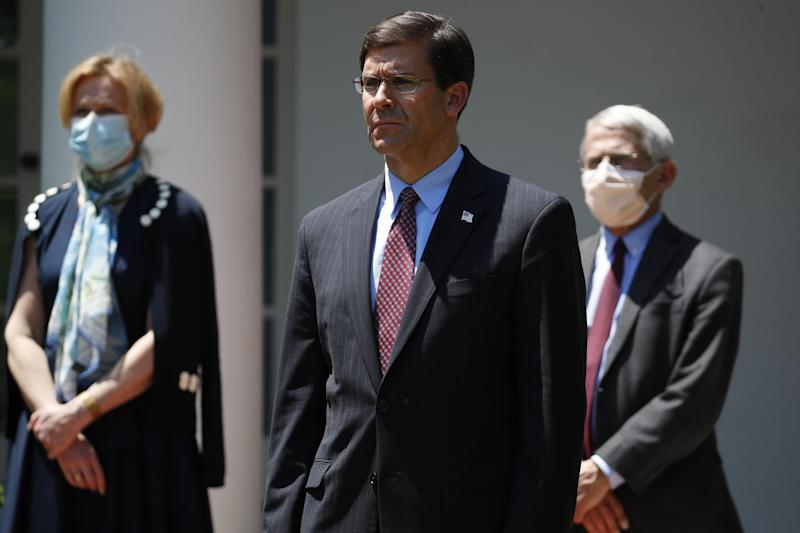 Defense Secretary Mark Esper pictured with White House coronavirus response coordinator Dr. Deborah Birx and Director of the National Institute of Allergy and Infectious Diseases Dr. Anthony Fauci: AP Photo/Alex Brandon