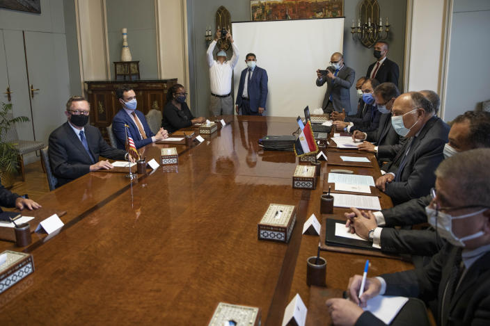 U.S. Special Envoy for the Horn of Africa Jeffrey Feltman, left, meets with Egyptian Foreign Minister Sameh Shoukry, third right, and their delegations, at the foreign ministry in Cairo, Egypt, Wednesday, May 5, 2021. (AP Photo/Nariman El-Mofty)