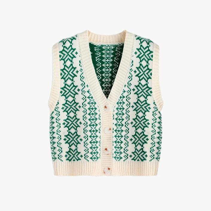 """$18, CIDER. <a href=""""https://shop.shopcider.com/collections/sweater/products/retro-print-button-up-knitted-vest"""" rel=""""nofollow noopener"""" target=""""_blank"""" data-ylk=""""slk:Get it now!"""" class=""""link rapid-noclick-resp"""">Get it now!</a>"""