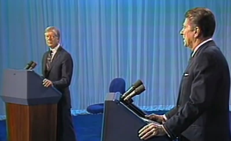 U.S. President Jimmy Carter and California Governor Ronald Reagan during a U.S. presidential election debate in Cleveland