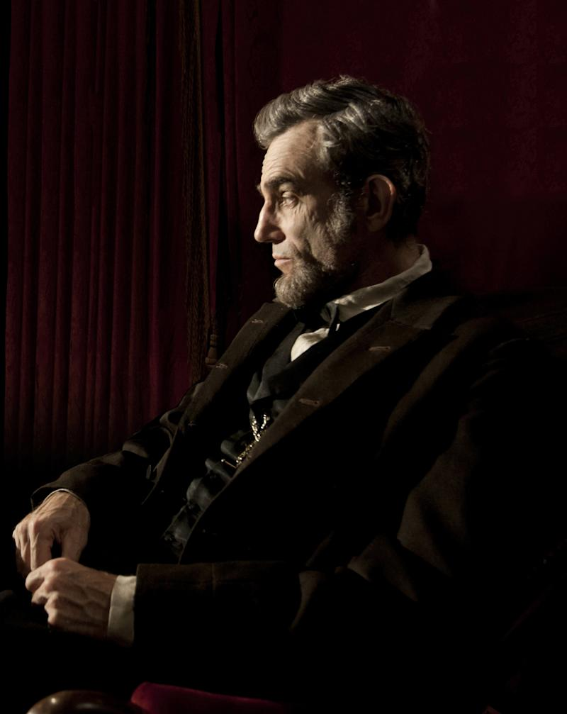 "FILE - This publicity film image released by DreamWorks and Twentieth Century Fox shows Daniel Day-Lewis portraying Abraham Lincoln in the film ""Lincoln."" ""Lincoln"" and ""Zero Dark Thirty"" are adding to their front-runner status for Hollywood's awards season. The two dramas earned nominations from the Writers Guild on Friday, Jan. 4, 2013, for outstanding screen writing. (AP Photo/DreamWorks, Twentieth Century Fox, David James, File)"