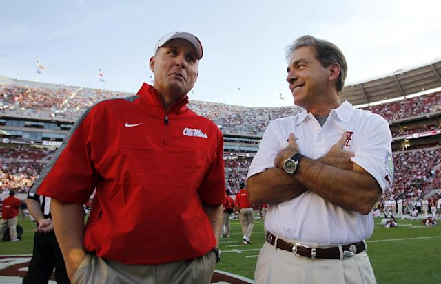 Alabama coach Nick Saban, right, talks with Mississippi oach Hugh Freeze before an NCAA college football game Saturday, Sept. 28, 2013, in Tuscaloosa, Ala. (AP Photo/Butch Dill)