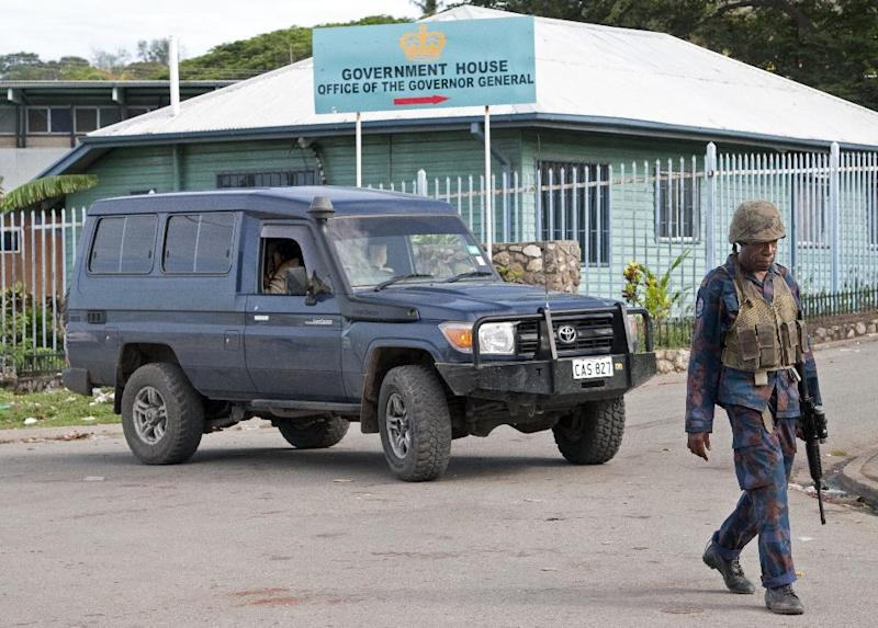 File photo taken in December 2011 shows Papua New Guinean Army special forces patrolling at Government House in Port Moresby