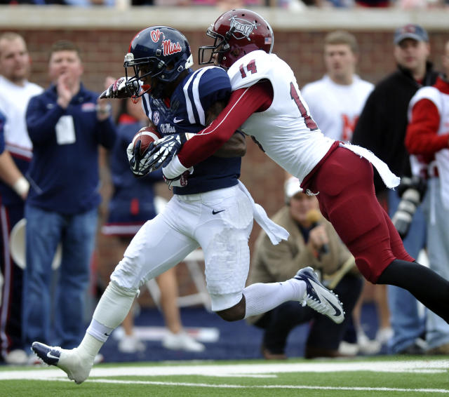 Mississippi running back I'Tavius Mathers (5) scores on a pass play as Troy safety Rishad Goode (14) defends during an NCAA college football game in Oxford, Miss., Saturday, Nov. 16, 2013. (AP Photo/Oxford Eagle, Bruce Newman)