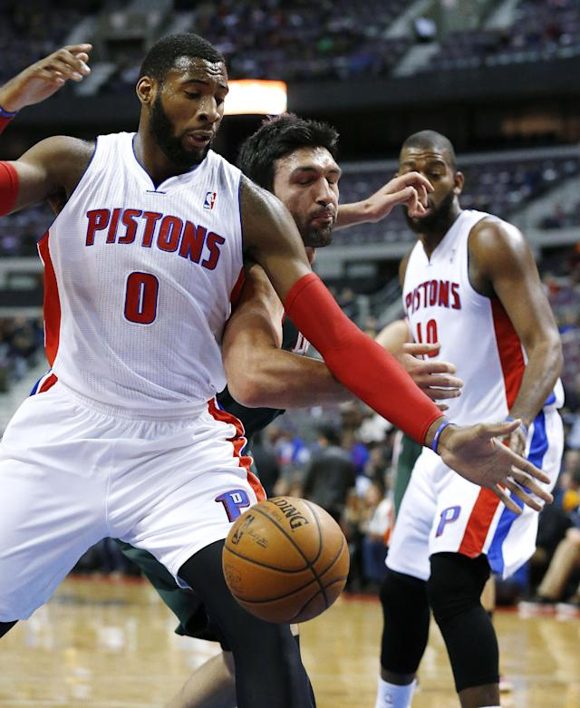 Detroit Pistons center Andre Drummond (0) and Milwaukee Bucks center Zaza Pachulia (27), of Georgia, battle for a loose ball in the first quarter of an NBA basketball game in Auburn Hills, Mich., Monday, Nov. 25, 2013. (AP Photo/Paul Sancya)
