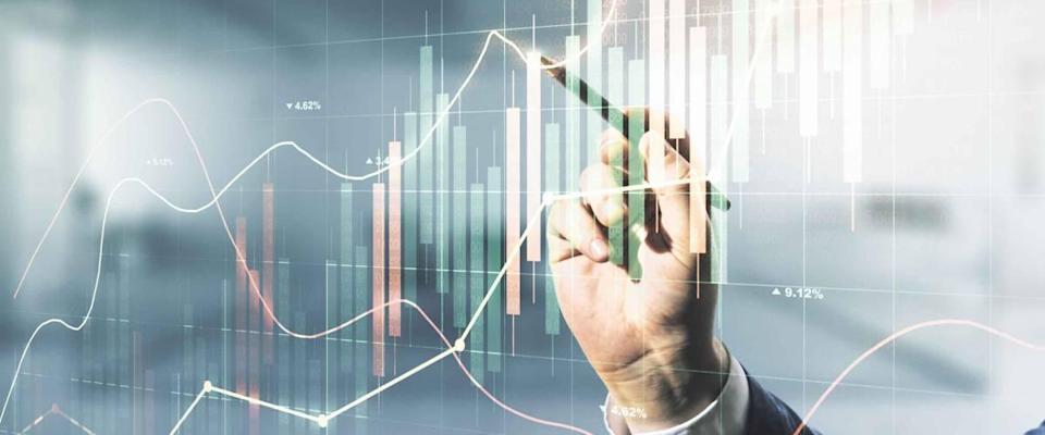 Multi exposure of businessman hand with pen working with virtual creative financial chart hologram on blurred office background, research and analytics concept