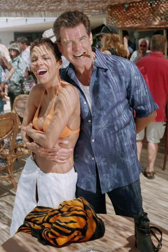 <p>Halle Berry and Pierce Brosnan on the set of 'Die Another Day', 2002. </p>