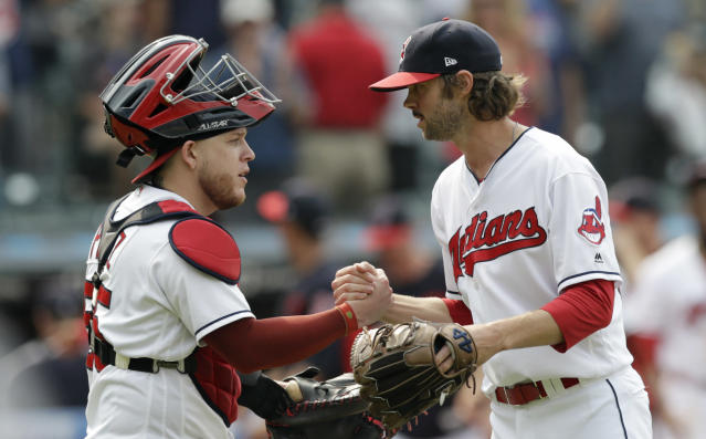 Cleveland Indians' Roberto Perez, left, and relief pitcher Adam Cimber celebrate after they defeated the Baltimore Orioles in a baseball game, Sunday, Aug. 19, 2018, in Cleveland. (AP Photo/Tony Dejak)